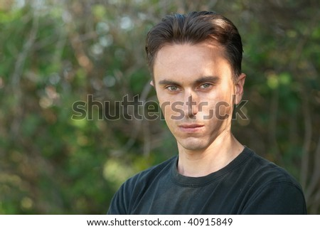 Man's portrait in the soft forest background #40915849