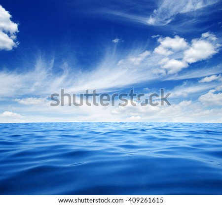 Blue sea water surface on sky #409261615