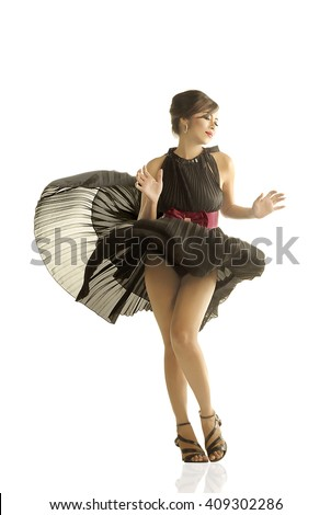 Title : Marilyn Monroe Style Description : Fashion shots with wind blows up models skirt like a Marilyn Monroe