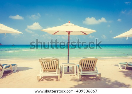 Beautiful tropical beach and sea landscape with coconut palm tree and umbrella and chair - vintage Filter and Boost up color Processing #409306867