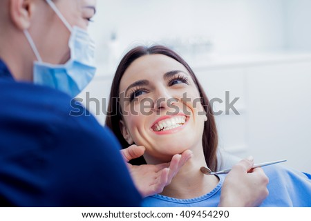 At the dentist. Female dentist in action. #409454290