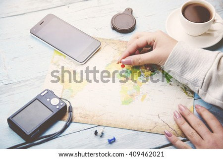 woman and map on wooden table #409462021