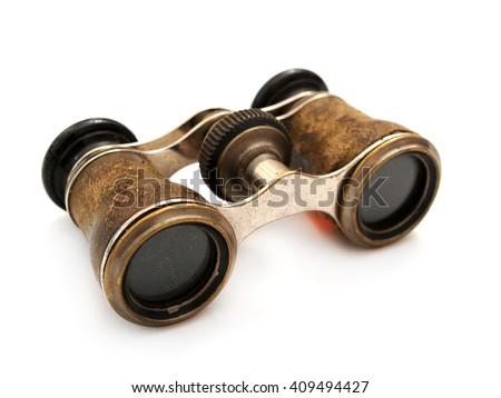 Antique brass binoculars at white background #409494427