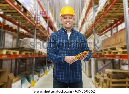 storage, shipment, logistic business, people and export concept - happy man with hardhat over warehouse background #409550662