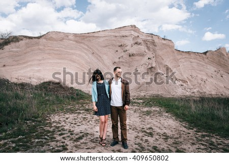 a beautiful couple on the background of the sandy cliff. close-up portrait #409650802