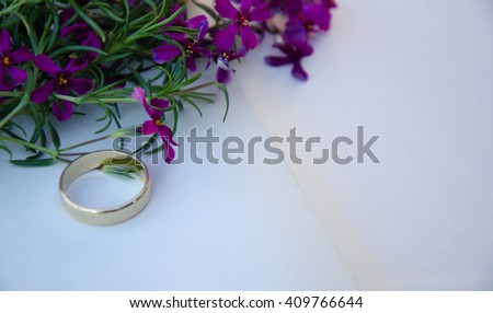 Wedding ring casting a heart-shaped shadow on the book #409766644