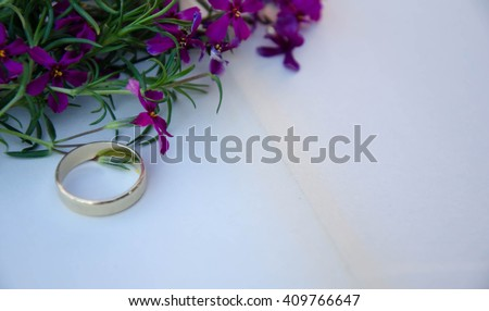 Wedding ring casting a heart-shaped shadow on the book #409766647