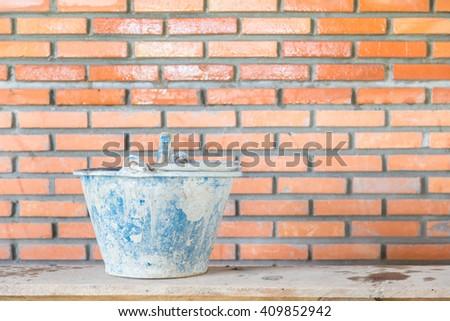 bucket and bricks. Under construction. #409852942
