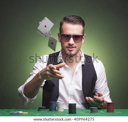 Poker player throwing cards at the table #409964275