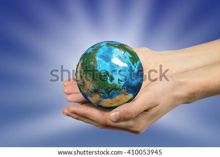 Human hand holding globe #410053945