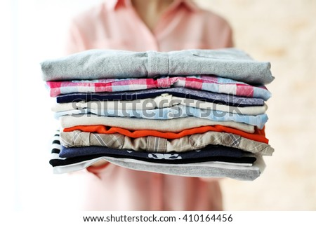 Woman holding clean male clothes, closeup #410164456