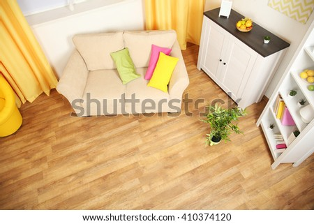 Modern living room interior with beige sofa, white furniture and bright decor #410374120