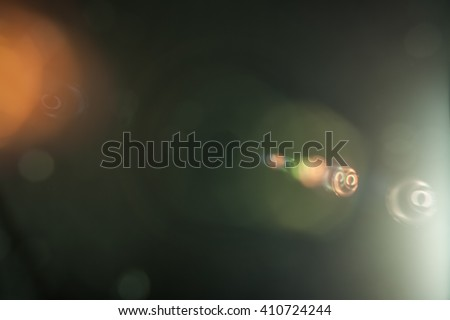 Real Lens Flare Shot in Studio over Black Background. Easy to add as Overlay or Screen Filter over Photos Royalty-Free Stock Photo #410724244