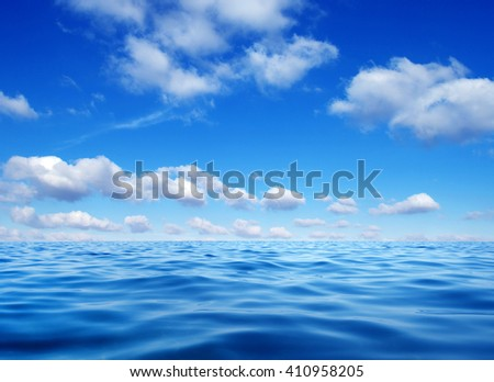 Blue sea water surface on sky #410958205