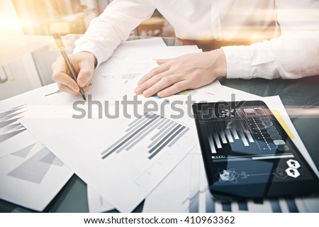 Investment manager working process.Picture trader work market report modern tablet.Using electronic device.Graphic icons,stock exchange reports screen.Business project startup.Horizontal,film effect