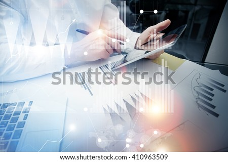 Bank trade manager working process.Concept photo trader work market report modern tablet.Using electronic device.Graphic icons,stock exchange reports screen interfaces.Business startup.Film effect