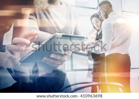 Business team work process.Double exposure photo professional crew working with new startup project.Investment managers meeting. Analyze business plans laptop.Blurred,film and bokeh effect. Horizontal