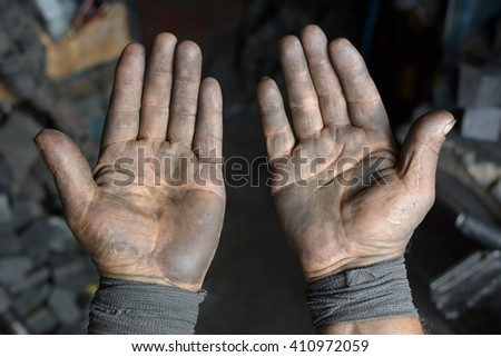 Two Palms Of Strong Male Laborer Hands Covered In Black Oil, First-person View -  Stock Photo #410972059