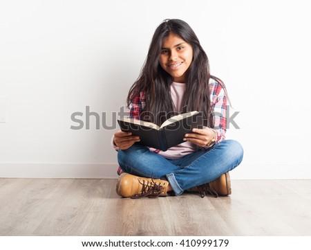 latin girl reading a book #410999179