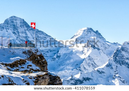 Balcony overlooking the Swiss Alps Royalty-Free Stock Photo #411078559