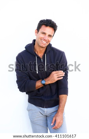 Portrait of a handsome mature man laughing against white background #411101617