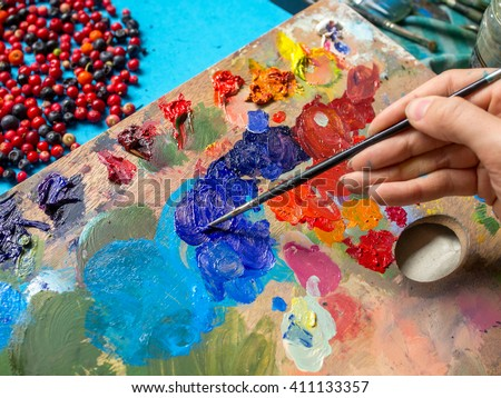 Painting. To paint a picture. To learn drawing. Female hands, paint brushes, oil paints and palette #411133357