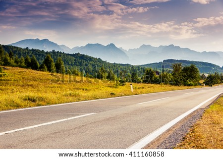 Fantastic mountain range glowing at sunlight. Dramatic and picturesque scene. Location famous place National park Durmitor, Balkans. Village Zabljak, Montenegro, Europe. Beauty world. Warm toning. #411160858
