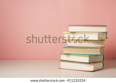 Stack of colorful books. Education background. Back to school. Copy space for text. #411220324