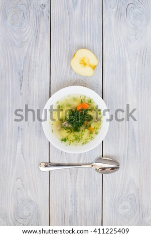 chicken soup and half of apple. flat lay #411225409