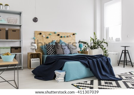 Shot of a bed in a spacious modern bedroom #411307039
