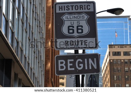 Begin Route 66 sign, Chicago Chicago,Illinois,USA - August 17, 2013 : The begin historic Route 66 sign on Adam Street  #411380521