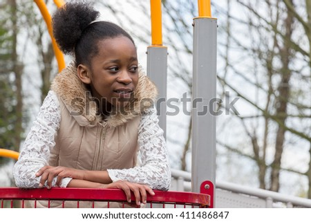 African child playing in children's activity park. #411486847