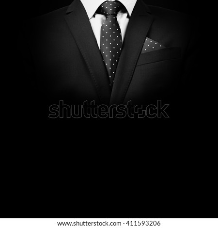 man in suit on a black background. studio shot Royalty-Free Stock Photo #411593206