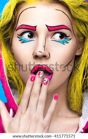 Photo of surprised young woman  with professional comic pop art make-up and design manicure. Creative beauty style and nails. Photos shot in studio