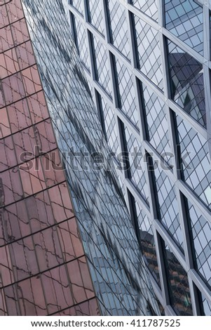 Skyscrapers with glass facade. Modern buildings in Paris business district. Concepts of economics, financial, future.  Copy space for text. Dynamic composition #411787525