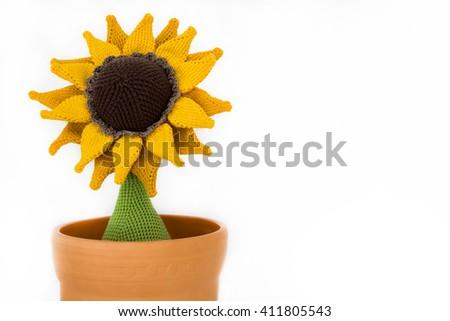 a crocheted sunflower in a flowerpot
