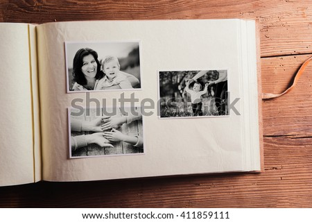 Mothers day composition. Photo album, black-and-white pictures. Royalty-Free Stock Photo #411859111