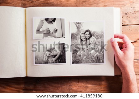 Mothers day composition. Photo album, black-and-white pictures. Royalty-Free Stock Photo #411859180