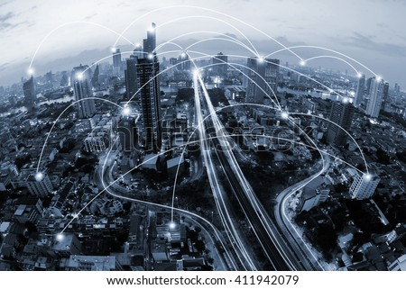 blue tone city and network connection concept.communication.smart city.internet of thing.Bangkok city Thailand.Big data