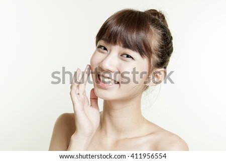 Close up portrait of beautiful young woman face. Isolated on white background. Skin care or spa concept #411956554