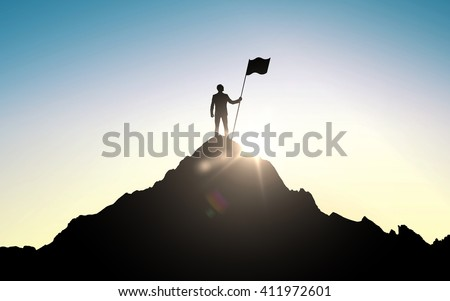 business, success, leadership, achievement and people concept - silhouette of businessman with flag on mountain top over sky and sun light background Royalty-Free Stock Photo #411972601