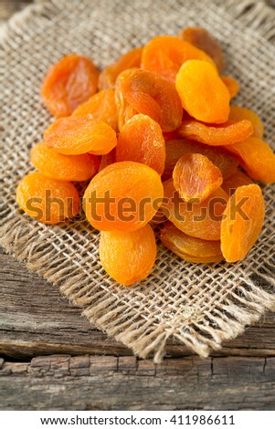 dried apricots on wooden table #411986611