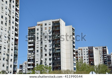 Line of residential buildings under clear spring sky #411990544