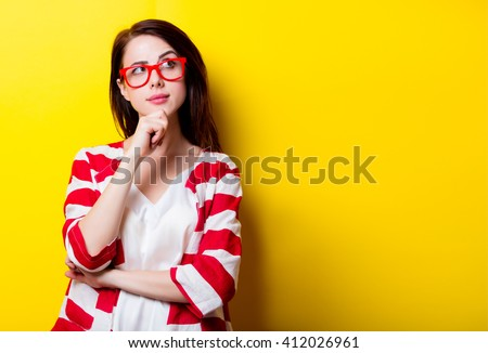 portrait of the beautiful young woman on the yellow background Royalty-Free Stock Photo #412026961