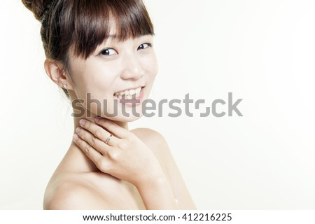Close up portrait of beautiful young woman face. Isolated on white background. Skin care or spa concept #412216225