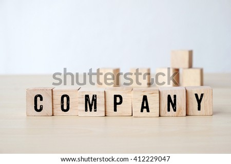 Company word on wooden cubes background, business concept #412229047