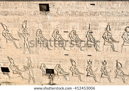 The bas-reliefs on the walls in the Ancient temple Karnak in Luxor. Egypt.  #412453006