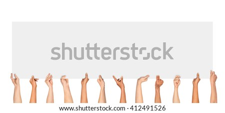 Many hands holding a blank poster for advertising on an isolated white background #412491526