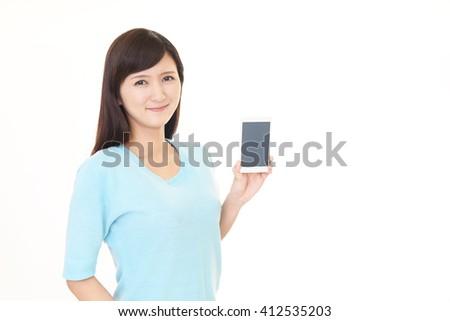 Woman using a smart phone #412535203
