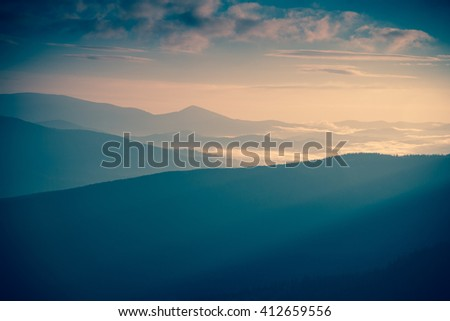Sunrise landscape of foggy and cloudy mountain valley. Instagram toning. #412659556
